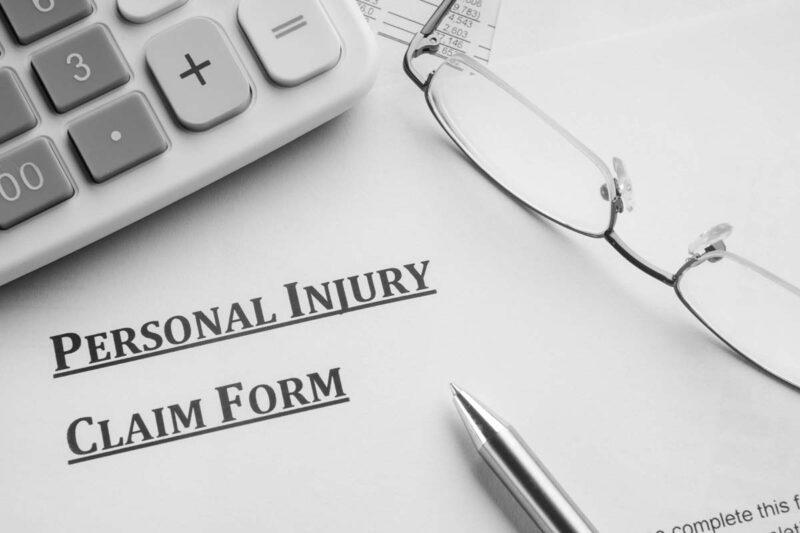 Personal Injury Claim Form On Desks